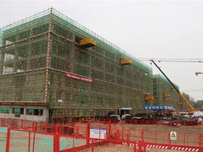 献礼国庆,兰州新区成功教育园第十二栋建筑喜封金顶!